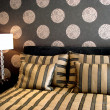 Modern bedroom luxurious black with wallpaper — Stock Photo