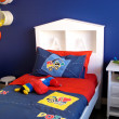 Vibrant blue boys bedroom - Stock Photo