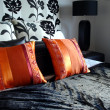 Modern bedroom luxurious black with orange red pillows — Stock Photo #6509756