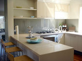 Sunny kitchen with breakfast bar — Stock Photo