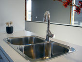 Kitchen with double sink — Stock Photo