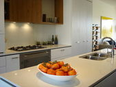 Modern kitchen warm tones open plan living — Stock Photo