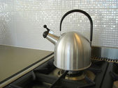Kettle on the stove — Stock Photo