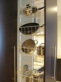 Kitchen storage for pots — Stock Photo