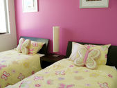 Pink and Yellow twin butterfly bedroom — Stock Photo