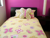 Pink and Yellow butterfly bedroom — Stock Photo