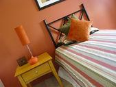 Modern bedroom warm tones orange — Stock Photo