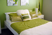 Modern bedroom bright green tones — Stock Photo