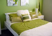 Modern bedroom bright green tones — Stock Photo