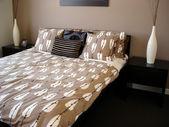 Modern bedroom chocolate and mocha tones — Stock Photo