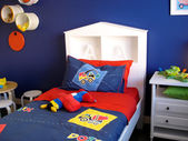 Vibrant blue boys bedroom — Stock Photo