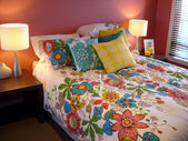 Vibrant red and multi coloured bedroom — Stock Photo