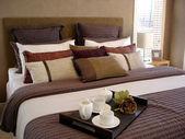 Breakfast in bed - master suite in earthy tones — Stock Photo
