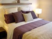 Modern bedroom with warm purple tones — Stock Photo