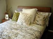 Modern bedroom chocolate and green grey tones — Stock Photo