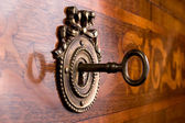 Old key in keyhole — Stock Photo