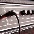 Black musical guitar amplifier panel with jack — Stock Photo