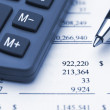 Calculator pen and financial report — Stock Photo