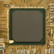 Black chip processor on circuit board - Photo