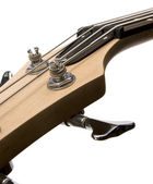 Bass guitar fingerboard head with pins and strings — 图库照片