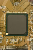 Black chip processor on circuit board — Stock Photo