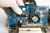 Installing video card into motherboard — Stock Photo