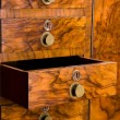 Wooden cabinet with opened drawer — Stok fotoğraf