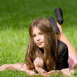 Royalty-Free Stock Photo: Girl lying in th park