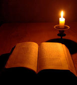 Old bible and candle — Stock Photo