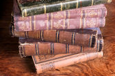 Stack of antique books backs — Stock Photo