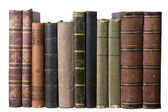 Isolated row with old books — Stock Photo