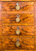 Wooden cabinet with closed drawer — Stock Photo