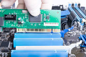 Installing PCI LAN card intop slot — Stock Photo
