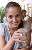 Woman with coffee in cafe — Stock Photo