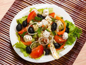 Greek salad on a white plate — Stock Photo