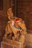 Elephant carrying divine in the ancient temple — Stock Photo