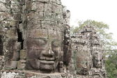 Budha Head. Fragment of stone carving in the ancient temple — Stock Photo