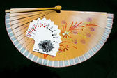 Hearts to Spades on a fan with black background — Stock Photo