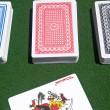 Stock Photo: Three card decks with red joker