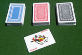 Three decks of cards with a joker — Stock Photo
