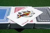 Card decks with a Joker — Stock Photo