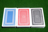 Three decks on playing table — Stock Photo