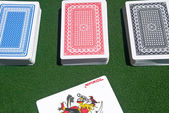 Three card decks with red joker — Stock Photo
