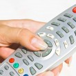 Handling remote control — Stock Photo