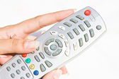 TV remote at woman hand — Stock Photo