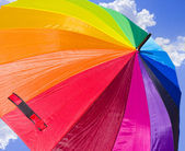 Rainbow Umbrella against the skies — Stock Photo