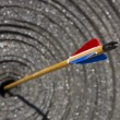 Arrow in the target (focus on feathers) — Stock Photo
