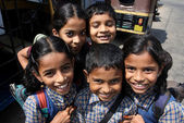 Happy Indian schoolchild come back from school — Stock Photo