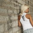 Beautiful blonde posing by the wall on the street — Stock Photo #6082039