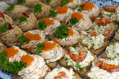 Canapes with caviar and paste — Stock Photo
